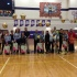 The volleyball seniors take a picture with their loved ones on senior night.